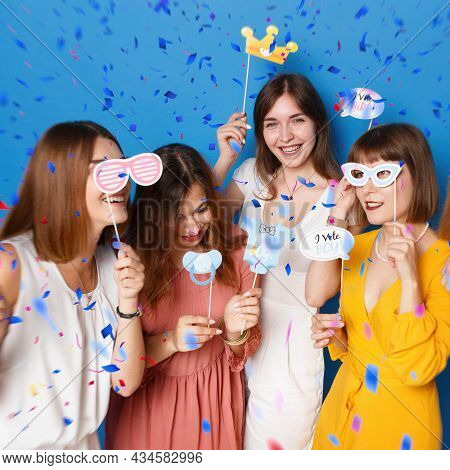 A Group Of Friends Happy To Have Gender Reveals Envent, Isolated Blue Background, Over Colored Confe
