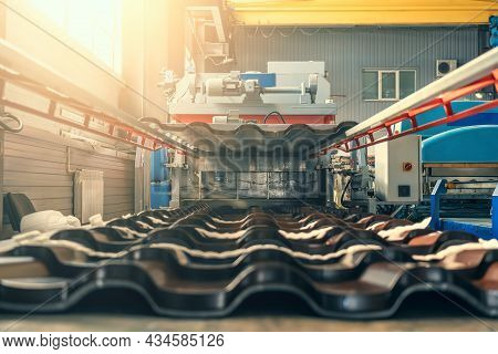 Metal Sheet Forming Machine In Factory For Production Materials For Roof And Facade Of Buildings. Pr