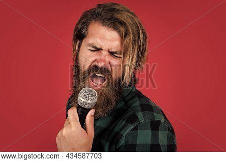 Bearded Man Wearing Checkered Shirt. Rock Music. Male Karaoke Singer. Mature Charismatic Male Vocali