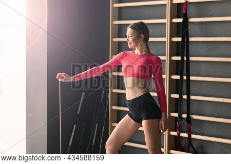 Young Muscular Woman Doing Core Exercise On Fitness Mat In The Gym, Doing Press-ups In Health Club.
