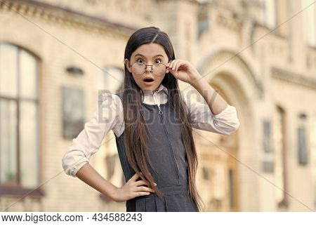 Wow. Surprised Child Look Through Glasses With Open Mouth. Back To School Fashion. School Uniform. F