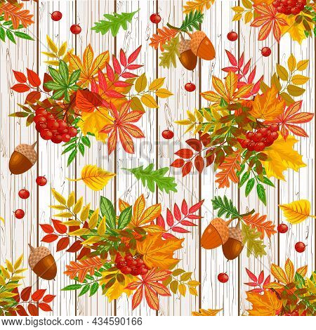 Autumn Leaves And Berries On A Wooden Background.autumn Bouquets Of Leaves, Berries And Acorns On A