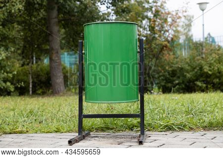 Green Dumpster In The Street. Horizontal Orientation.