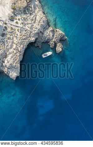 Drone Aerial Photograph Of Cape Greko Peninsula With Agioi Anargyroi Church On The Rocks. Cruise Tou