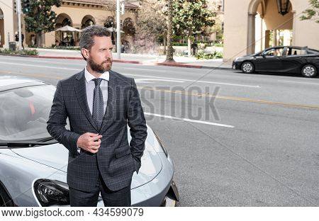 Handsome Mature Man In Businesslike Suit Stand By Luxury Car Outdoor, Copy Space, Success.