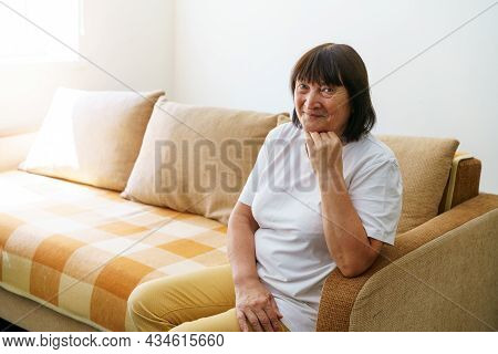 Portrait Shot In Head Of Peaceful Calm Middle Aged Woman Relaxing On Cozy Sofa Alone At Home. Nice H