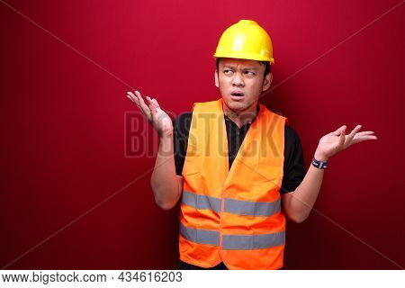 Thinking Young Asian Man Worker Is Seriously Think Gesture On Red Background