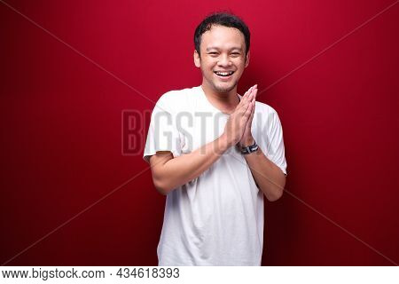 Smirk Smiling Face Of Young Asian Man With Greeting Hand