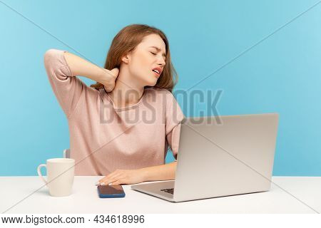 Sick Young Woman Employee Sitting At Workplace With Laptop Feeling Unwell With Sore Neck, Hurting Sh