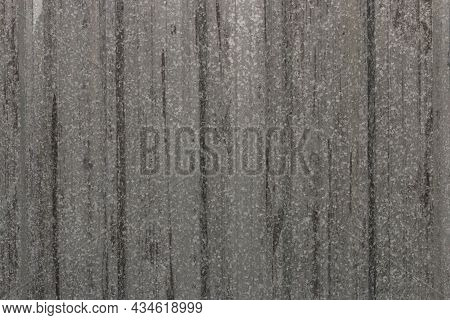 Gray Corrugated Metal Or Zinc Textured Surface Or Galvanized Steel Against A Vertical Line Or Textur