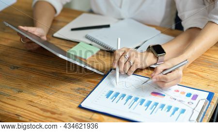 Female Mentor Teaching And Coaching Her New Financial Assistant