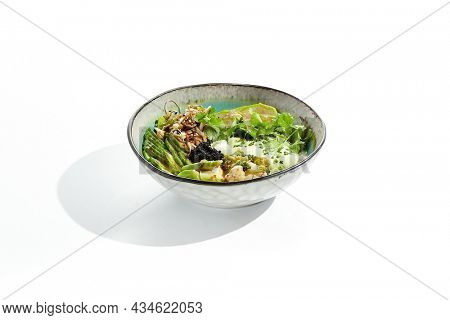 Vegan food - poke bowl with vegetables, edamame beans, soybean sprouts. Poke bowl with avocado and vegetables isolated on white background. Eat less meat. Plant - based eating