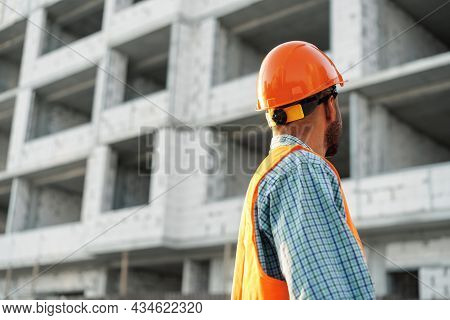 Close Up Of Unrecognizable Man Foreman In Workwear On Construction Site