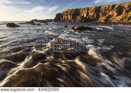 Water Flowing In The Ocean Looking Towards A Cliff At Windang Island On Nsw South Coast