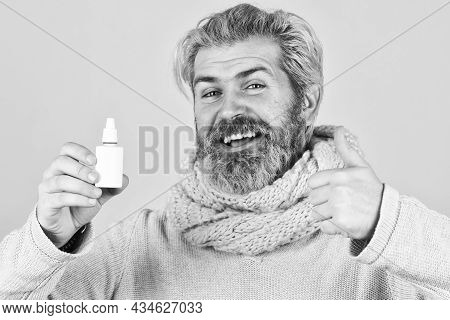 Man Scarf Hold Nasal Spray. Medicines Effective Recovery. Recommended Medical Treatment. Runny Nose