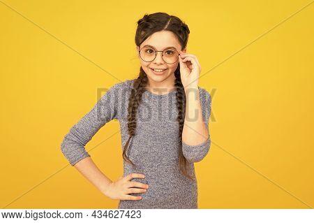 Fashion Eyewear And Trendy Eyeglasses. Happy Fashionista Yellow Background. Little Child With Long H