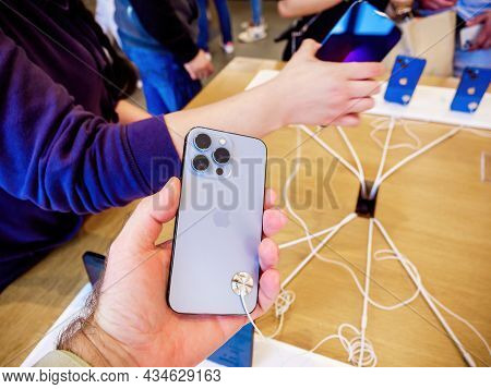 Paris, France - Sep 24, 2021: Customers Looking At New Iphone 13 Pro Max Smartphone Model By Apple C