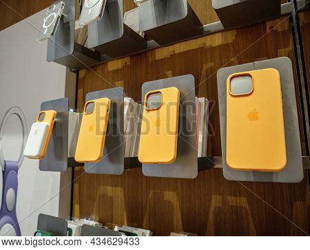 Paris, France - Sep 24, 2021: Orange Yellow Silicone Protection Cases Of Iphone 13 Pro At The Apple
