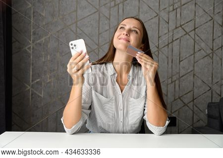 Headshot Of Excited Young Woman Doing Long Awaited Purchase Online, Happy Female Holds Smartphone An