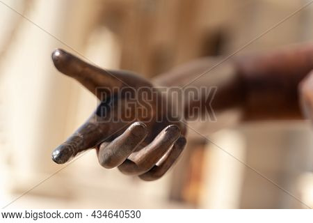 Closeup Detail Of Bronze Statue Hand Reaching Out With The Index Finger