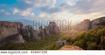 Greece. Meteora. Monasteries On The Rocks And Summer Sunset Sky Clouds