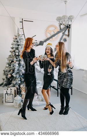 Christmas Celebration, New Year Eve Party, Festive Friends Get-togethers And Parties. Three Beautifu
