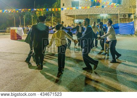 Safed, Israel - September 28, 2021: Jewish Men Dance, Part Of Simchat Torah Tradition, Women Are Beh
