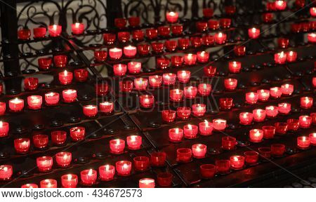 Many Red Votive Candles Inside The Place Of Worship Without People
