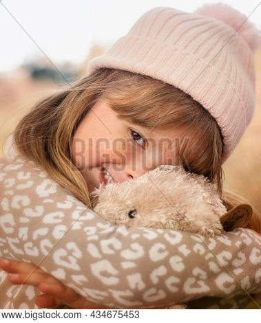 Cute Little Girl Cuddling Her Teddy Bear