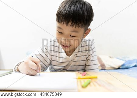 Home School And New Normal Lifestyle Concepts.asian Boy Studying Through Online Media And Do Homewor