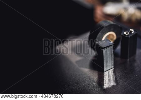 9 Volt Dead Battery With Terminals Covered With Electrical Tape For Safety