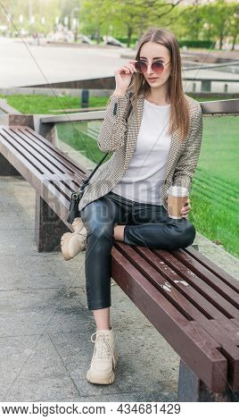 Beautiful Young Fashion Stylish Woman With Cup Of Coffee