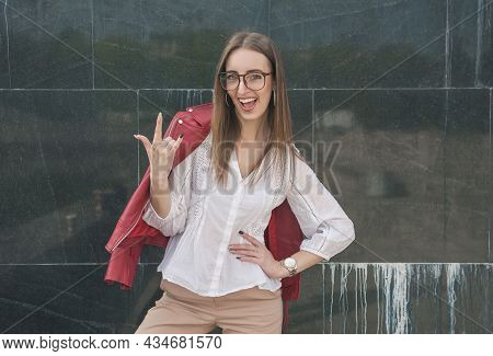 Beautiful Young Fashion Stylish Woman Showing Horns Gesture