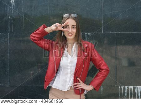 Beautiful Young Fashion Stylish Woman Showing V-sign Gesture