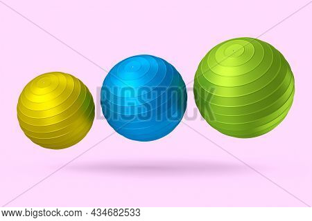 Multicolor Fitball Or Fitness Ball Isolated Pink Background. 3d Rendering Of Sport Equipment For Fit