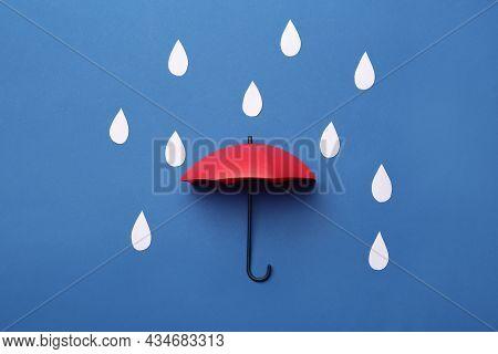 Mini Umbrella And Paper Raindrops On Blue Background, Flat Lay