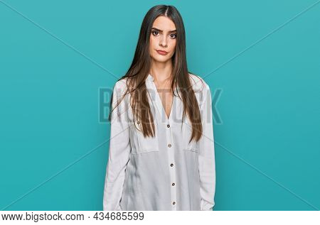Young beautiful woman wearing casual white shirt skeptic and nervous, frowning upset because of problem. negative person.