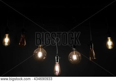 Old Vintage Light Bulb On The Wires Hanging From The Ceiling In The Total Darkness Home Decoration B