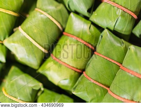 Khao Tom - Popular Laotian And Thai Dessert. Steamed Sticky Rice With Filling Wrapped In Banana Leav