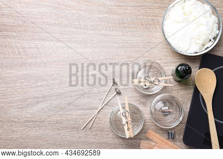 Flat Lay Composition With Homemade Candles Ingredients On Wooden Background, Space For Text