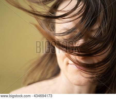 Wellness, Cosmetics And Hairstyle. Portrait Of Beautiful Woman Model With Flying Straight Hair Whick
