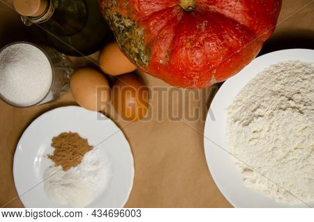 Concept Homemade Fall Baking With Pumpkin And Food Ingredients. Cooking Pumpkin Pie. Ripe Pumpkin, F