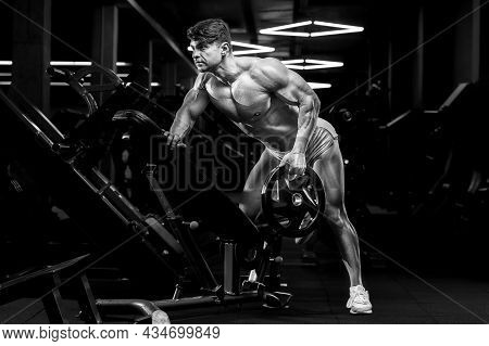 Athletic Man Doing Bent Over Row Muscles