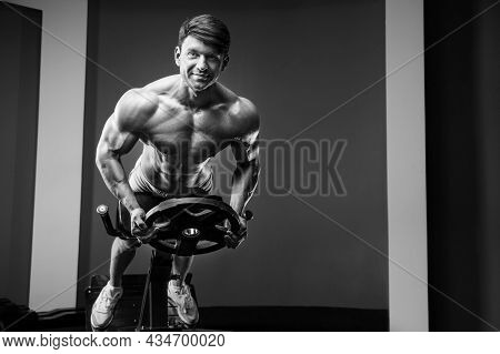 Athletic Man Exercising Pumping Up Muscles