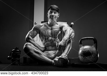 Handsome Strong Athletic Man Next To A Kettlebell