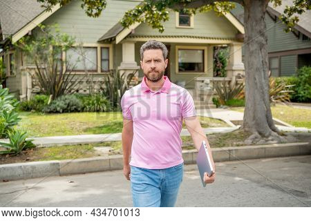 Ownership. Mature Settlement Agent With Laptop Walk Outdoor. Real Estate Agent Sell Property.