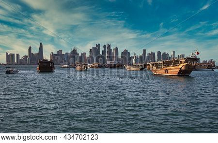 Doha, Qatar -20 September 2021 :doha Skyline From The Corniche Promenade Afternoon Shot Showing Dhow