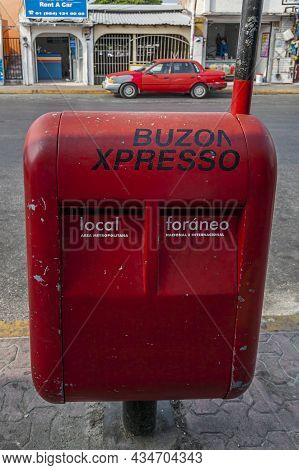 Mexico, May 2011 - Red Mailbox For Local And International Mail On The Sidewalk Of A Street In Playa
