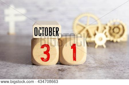 October 31Th. Image Of October 31 Wooden Color Calendar On White Brick Wall Background. Empty Space