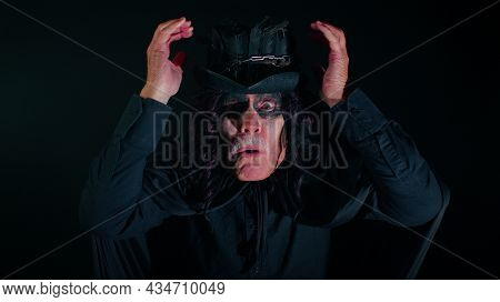Wow. Frightening Senior Man With Halloween Witcher Makeup Raising Hands In Surprise Looking At Camer